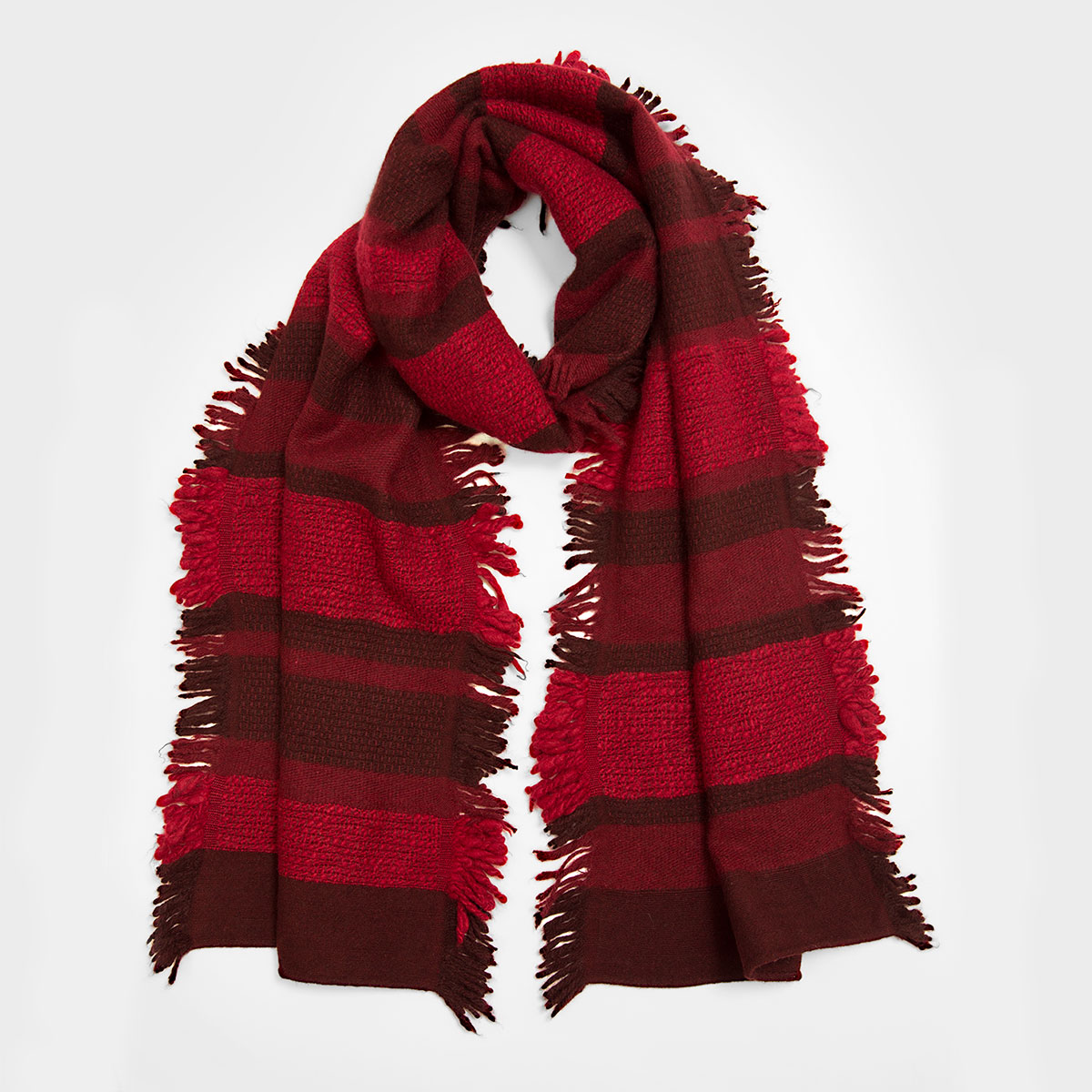 The stunning array of crimson, scarlet, and burgundy stripes transform this classic fall accessory into a covetable statement piece. Its 100% yak wool composition is the new standard in luxury fibers-- soft as cashmere, but with superior warmth and durability. 